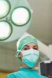 Surgeon under surgical lights