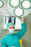 Surgeon holding a surgery light
