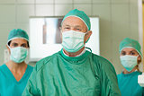 Surgeon with two interns behind him