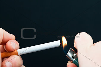 Someone lighting a cigarette