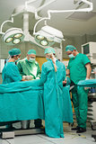 Team of surgeons working on a patient