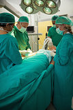 Patient being operated by a team of surgeon
