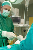 Surgeon holding scalpel during an operation