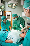 Medical team of surgeon working