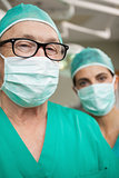 Man surgeon with glasses and a colleague