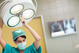 Woman holding a surgical light