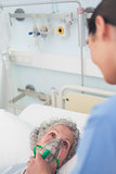 Patient having an oxygen mask on her face
