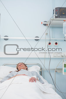 Female patient sleeping on a medical bed