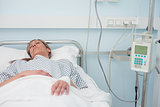 Woman sleeping on a medical bed