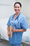 Smiling nurse holding a medical chart