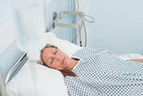 Female patient lying on a bed with closed eyes