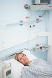 Female patient looking at camera while lying on a bed