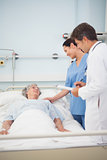 Doctor and nurse speaking to a patient