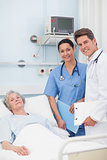 Patient with her doctor and nurse looking at camera