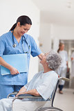 Nurse standing next to a patient in a wheelchair