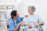 Elderly patient looking at a nurse