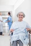 Elderly patient in a wheelchair in a corridor