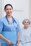 Nurse holding a folder
