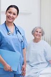 Smiling nurse holding a folder