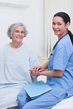 Nurse holding hand of a patient