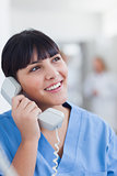 Smiling nurse holding a phone