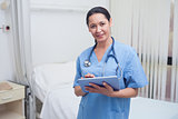 Nurse using a tablet pc