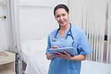 Nurse using a tablet pc