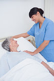 Nurse touching the shoulder of a patient