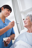 Nurse feeding a patient
