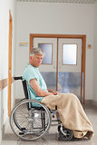 Patient sitting in a wheelchair with a blanket