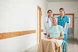Patient in a wheelchair next to nurses