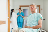 Male patient in a wheelchair looking at camera