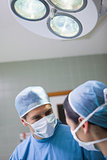 Doctor looking at a nurse below the light