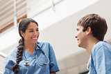 Female nurse talking with a male nurse