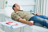 Transfused patient lying on a bed