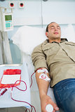 Male patient receiving a transfusion