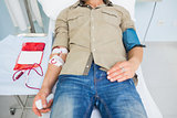 Male patient receiving a blood transfusion