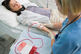 Nurse removing the transfusion