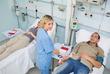 Transfused patients and a nurse looking at camera