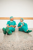 Surgeons sitting on the floor