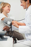 Doctor examining blood pressure of a child