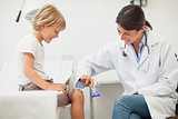 Doctor testing reaction of a child leg