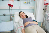 Female transfused lying on a bed