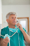 Surgeon talking while holding a phone