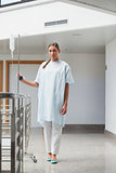 Patient walking with a drip stand