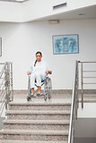 Female patient sitting on a wheelchair