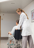 Doctor pushing a wheelchair