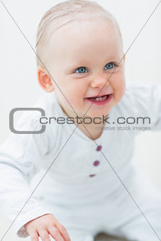 Smiling baby looking up