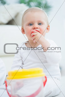 Baby putting a toy in his mouth
