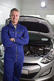 Mechanic standing while looking at camera